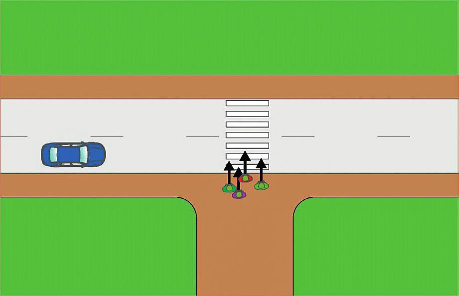 Skupina chodců vstupuje na přechod, červený chodec se rozmýšlí