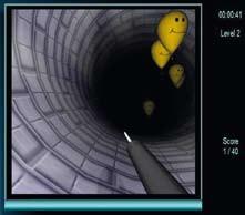 Výcvikový program EndoBubble. Na počítačovém displeji se zobrazuje jehla, kterou je možno navigovat tunelem pomocí endoskopu. Úkolem výcviku je propíchnout jehlou balonky, které se v tunelu vznášejí. Fig. 2. EndoBubble Training Programme. The video display shows a needle that can be navigated through a tunnel under the endoscopic control. The object of the exercise is to use a needle to touch and pierce balloons floating in the tunnel.