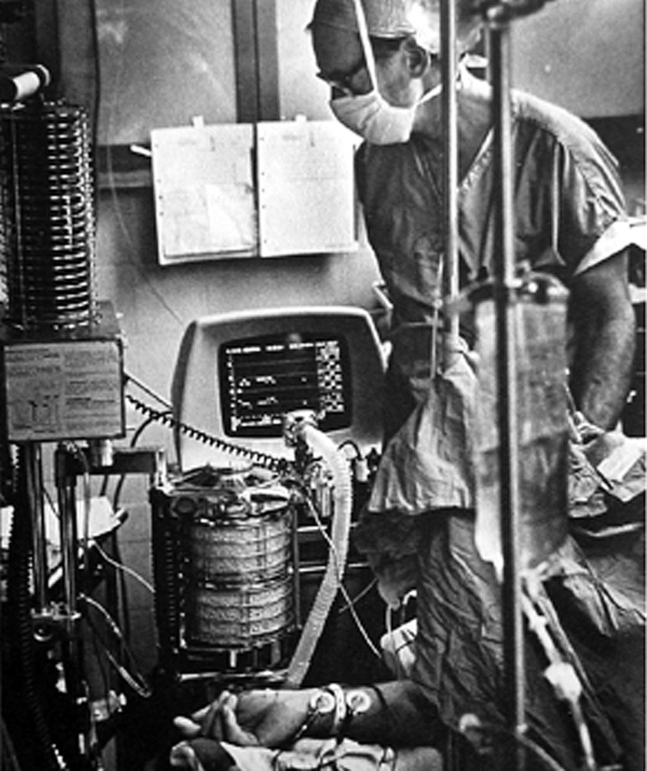 The author in the operating room with a terminal of the mass spectrometer system displaying the time courses of end tidal PCO2 and halothane anesthetic in his patient