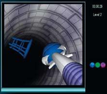Výcvikový program EndoBasket. Na počítačovém displeji se zobrazuje vinutý tunel s balonky a košíky. Úkolem výcviku je zachytit balonek endoskopickými klíšťkami a vložit ho do košíčku stejné barvy. Fig. 3. EndoBasket Exercise Programme. The video display shows a winding tunnel with balls and baskets. The object of the exercise is to grasp the ball with the endoscopic forceps and drop it into the basket of the same colour.