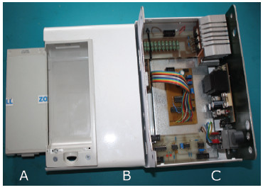 Fig. 3: Mechanical conception of the testing device. A - an original ZOLL lead-acid battery pack, B – a battery pack berth (original ZOLL), C – metallic box with the printed circuit boards.
