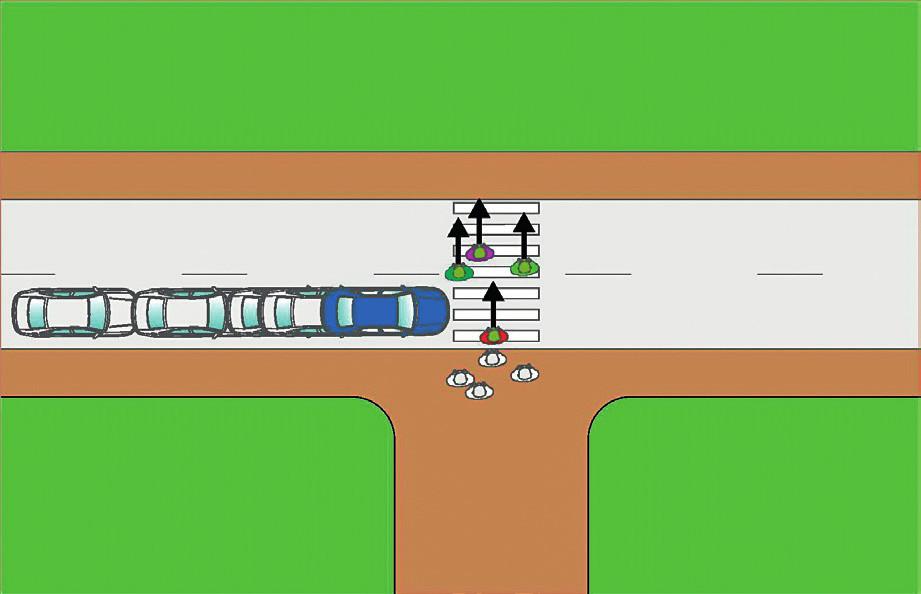 Skupina opouští jízdní pruh, červený chodec teprve začal přecházet