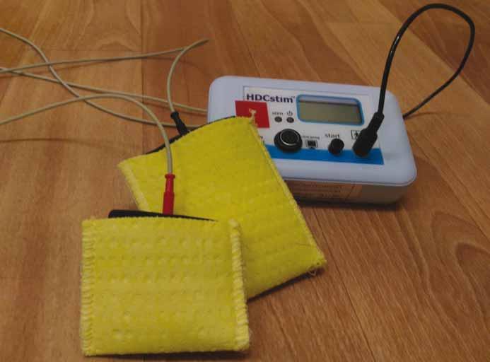 Přístroj pro transkraniální stimulaci stejnosměrným proudem HDCstim (The Magstim Company Ltd., Whitland, Velká Británie).<br> Fig. 1. Machine for transcranial direct current stimulation HDCstim (The Magstim Company Ltd., Whitland, UK).