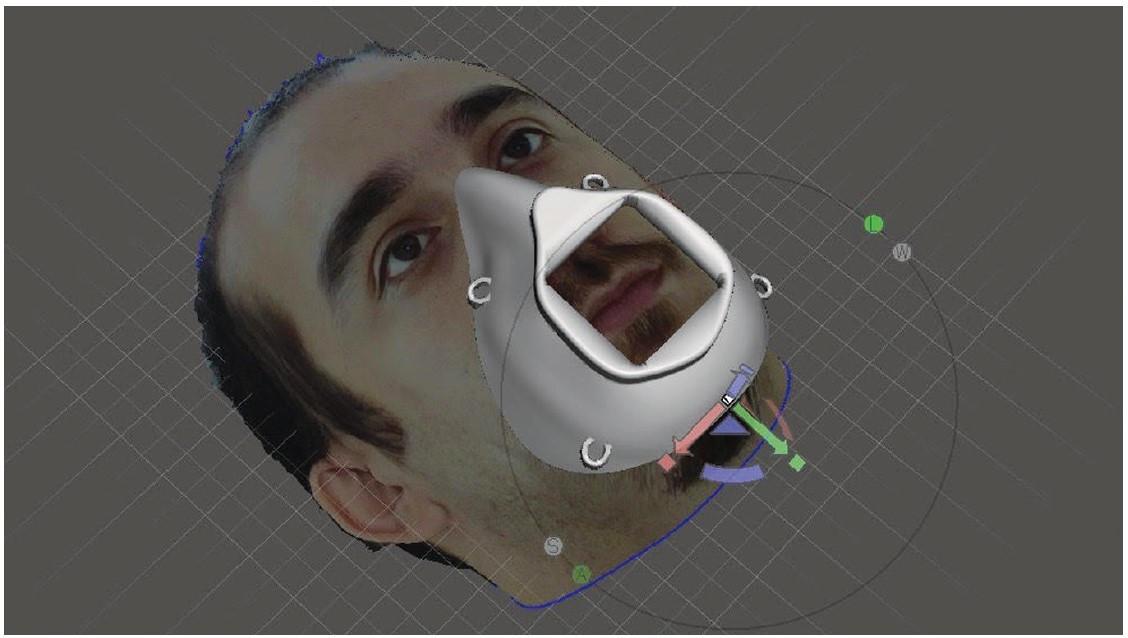 Obr. 6 Pohled na design personalizované ochranné masky se skenem obličeje Dr. Saygiliho<br> Fig. 6 View of the design of personalised protective mask with the face scan of Dr. Saygili