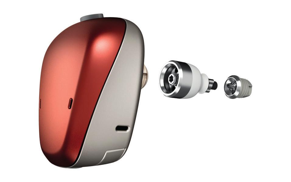 Baha Connect®. V levé části obrázku je zvukový procesor, uprostřed abutment procházející kůží a vpravo implantát. (Zdroj: Cochlear, Sydney, Austrálie.)